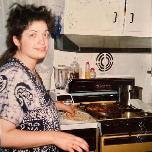 Raj's mother, Loretta cooking in the kitchen.