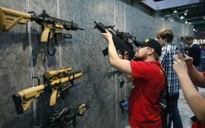 Nolan Hammer looks at a gun
