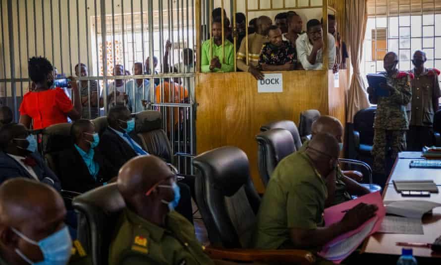 Ali Bukeni, Daniel Brenny Oyerwot, Eddy Ssebuufu and others at a bail hearing.