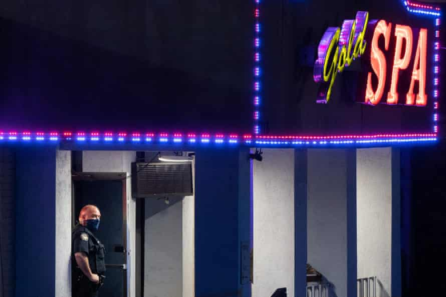 A police officer stands outside a massage parlor where three people were shot and killed on 16 March 2021, in Atlanta, Georgia.