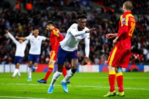 Tammy Abraham from England shoots a goal to make it 7-0 and points to Jadon Sancho of England, who provided the template.