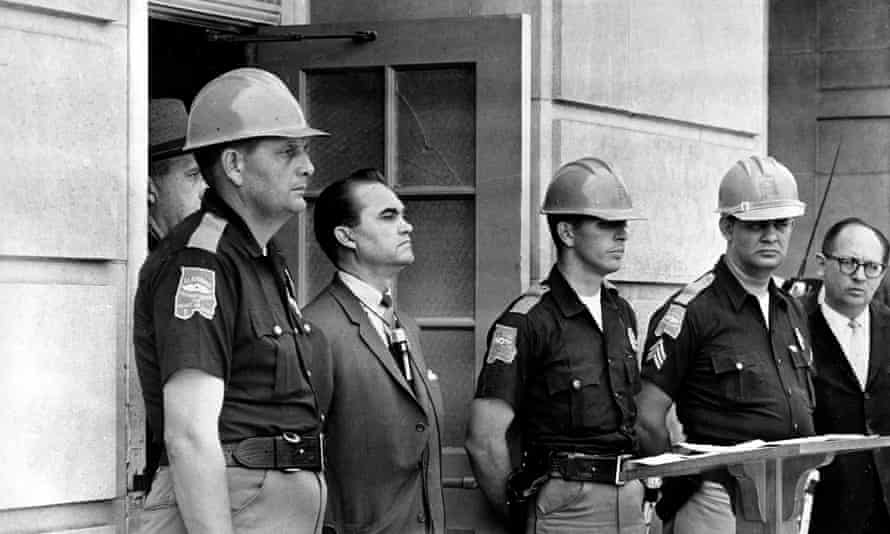 Governor George Wallace blocks the entrance to the University of Alabama on June 1963 as he turned back a federal officer attempting to enroll two Black students.