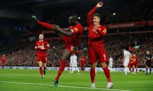 Liverpool's Sadio Mane celebrates scoring the second goal with Roberto Firmino.
