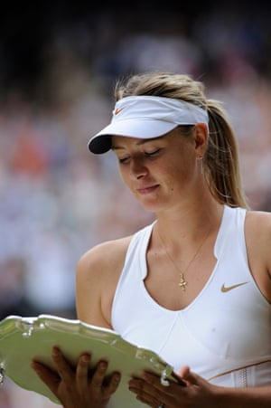 A dejected Maria Sharapova looks at her runners up plate after her defeat to Petra Kvitova at the 2011 Wimbledon tournament.