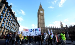 Protestors march to Downing Street to demonstrate against the housing bill.
