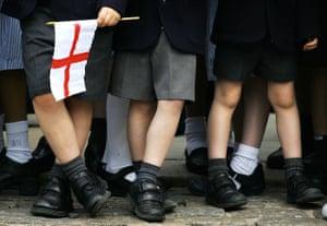 legs of schoolchildren with English flag