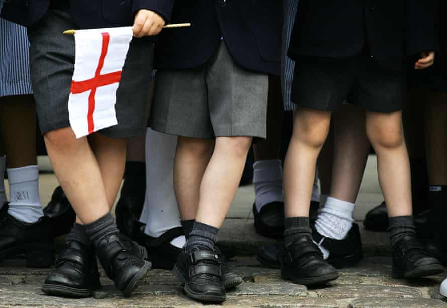 legs of schoolchildren with English flag