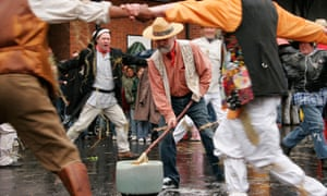 The outdoor village pub game of Dwile Flonking held at Harvey's brewery in Lewes, East Sussex
