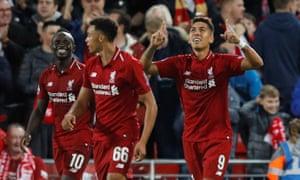 Liverpool's Roberto Firmino celebrates his late winner against PSG.