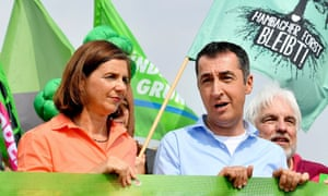 Katrin Göring-Eckardt and Cem Özdemir, joint leaders of the German Green party, at a coal mining protest in Manheim.