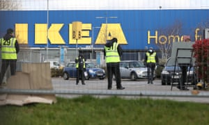 Stewards organise traffic at a Covid-19 test centre for NHS workers which has opened at Ikea's store in Wembley.