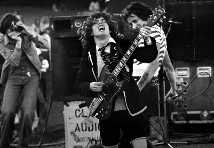 Angus Young and Bon Scott in AC/DC in 1970s.