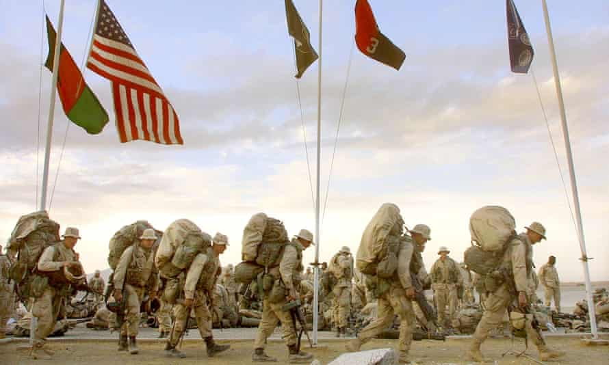 US Marines from India company march as they prepare to depart the American military compound at Kandahar airport, Afghanistan.