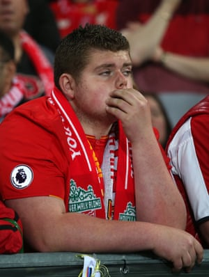 Liverpool fans are dejected.
