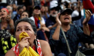 A woman cries during a rally in Caracas, where opposition supporters pay tribute to victims of violence in protests against Maduro's government.