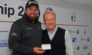 Shane Lowry is presented with honorary life membership of the European Tour by chief executive Keith Pelley