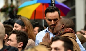 Men embrace during a minute's silence in memory of the victims of the gay nightclub mass shooting in Orlando, in the Soho district of London on Monday.