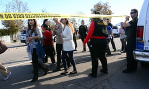 Survivors are evacuated from the scene of the shooting in San Bernadino, California.