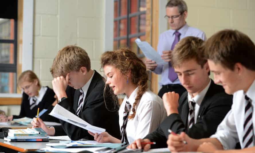 A girl reads aloud during an English lesson at Pates grammar school in Cheltenham, Gloucestershire.