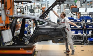 Workers assemble Audi sedans on an assembly line at the Ingolstadt plant