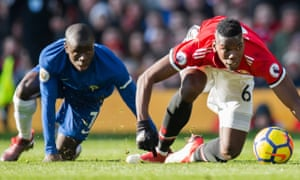 Chelsea's N'Golo Kanté with Paul Pogba in Manchester United's 2-1 home win in February 2018