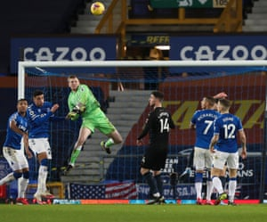 Everton keeper Jordan Pickford punches the ball clear.