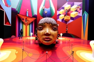 A visitor looks at an artwork that forms part of the OsGemeos exhibition, titled Secretos [Secrets] in São Paulo, Brazil