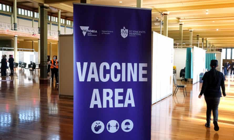 "a sign saying ""Vaccine area"" sunlit wooden hall"