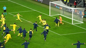 Villarreal's goalkeeper Geronimo Rulli (righ) celebrates with teammates after saving the decisive penalty during the penalty shoot-out.