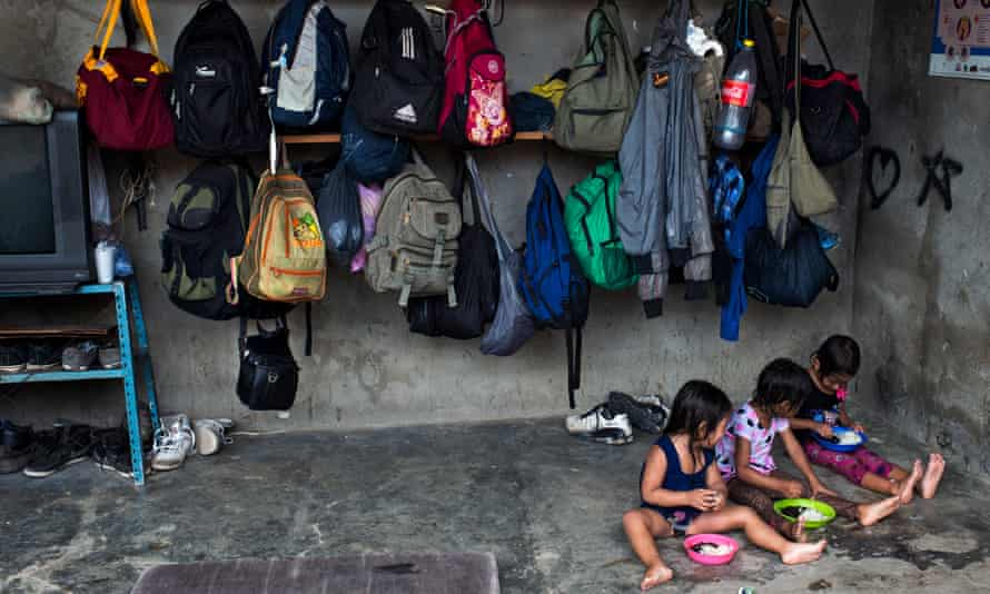 Children eat at a shelter for migrants in Chauites, Oaxaca. Shelters for migrants have tripled in population since the Southern Border Plan started in 2014.