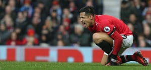 Manchester United's Alexis Sanchez goes down injured after scoring his first goal United as they beat Huddersfield Town 2-0 at Old Trafford.