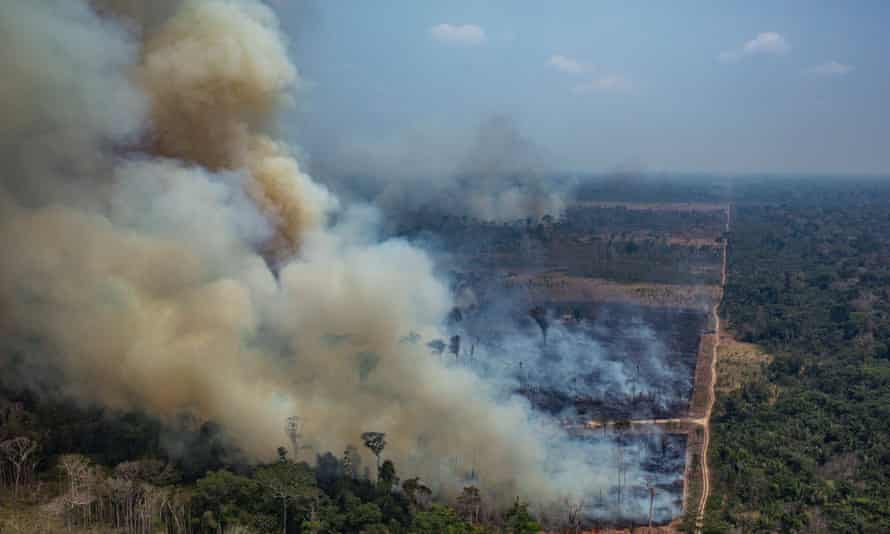 Smoke billowing from forest fires in the municipality of Candeias do Jamari, in Rondonia State, northwestern Brazil, on 24 August 2019.