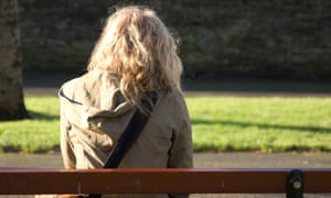 Young woman sitting on park bench