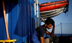 A Tunisian man sits on the German NGO Sea-Eye rescue ship Alan Kurdi in international waters off Malta in the central Mediterranean