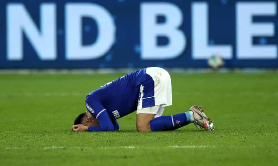 Ahmed Kutucu falls to the ground following his team's defeat to Arminia Bielefeld.