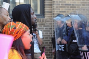 Bruce Franks, a former Missouri state representative, faces police in riot gear as protestors demonstrate in St Louis in 2017.