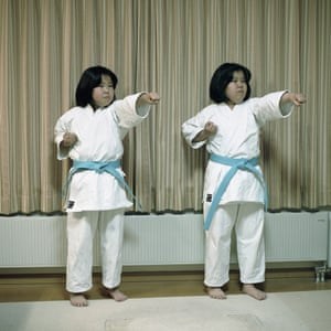 Two Ainu sisters demonstrate karate forms in the house where they live with their parents. They study martial arts in the village cultural centre where they also study Ainu language