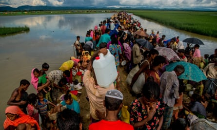 A large group of Rohingya people try to cross the border in Palongkhalii of Cox's Bazar, Bangladesh.