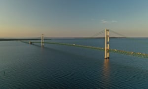 The Mackinac Bridge that spans the Straits of Mackinac, which connect Lake Huron and Lake Michigan.