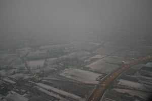 Haze and smog envelop Warsaw on a snowy February day