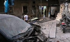 Medics inspect the damage outside a field hospital after in the rebel-held al-Maadi neighbourhood of Aleppo.