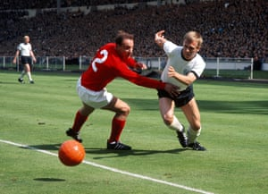 Siegfried Held tries to break past George Cohen. Held's team-mate, Helmut Haller, opened the scoring in the 12th minute only for Geoff Hurst to get England back on level terms six minutes later