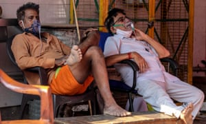 Suspected Covid-19 patients receive oxygen at a Sikh shrine in Delhi, India.