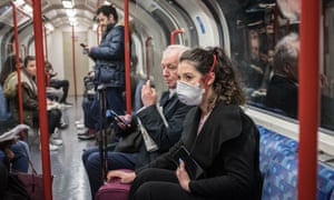 Woman wears face mask on tube