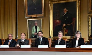 Sir Gregory Winter and Prof Frances Arnold sit with other Nobel prizewinners at a press conference ahead of Monday's ceremony