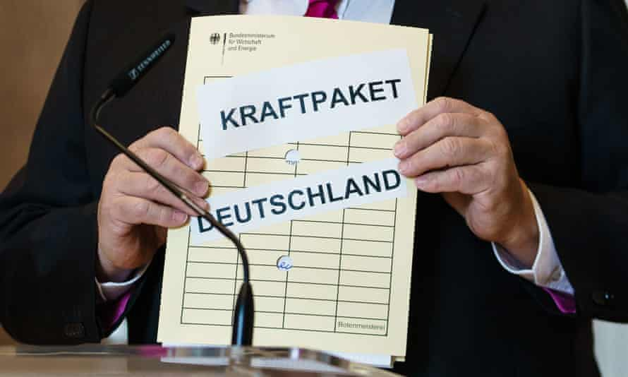 A file reading Kraftpaket Deutschland (Powerhouse Germany) is displayed during a press statement at the economy ministry in Berlin on the economic stimulus package