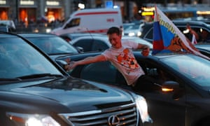 People in Moscow celebrate Russia's victory over Spain