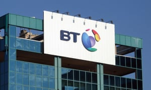 The logo of BT is seen outside the headquarters in Milan.
