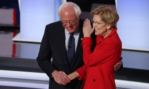 Democratic presidential candidate Bernie Sanders and Elizabeth Warren greet each other at the start of the Democratic presidential debate