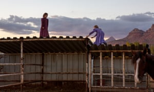 FLDS girls Lydia Richter, 8, and Kathy Bistline, 8, play on top of a makeshift stable in Colorado City, Arizona